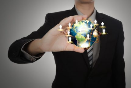 businessman-holding-a-planet-earth-with-people-symbols_1232-896